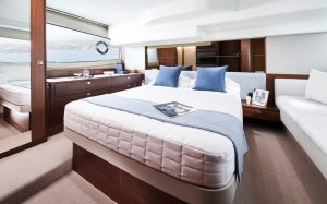 f50-interior-owners-stateroom-walnut-satin